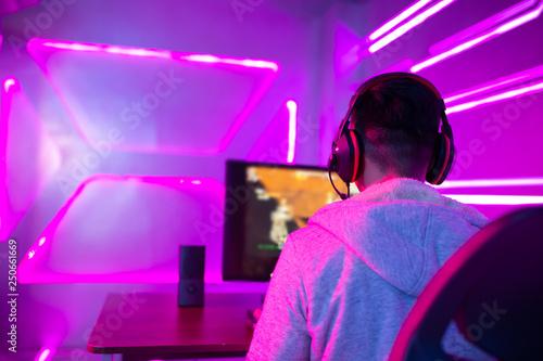 Fotografie, Obraz  Young Asian cyber sport gamer