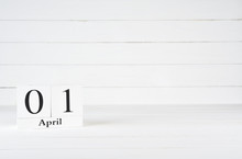 April 1st, Day 1 Of Month, Orissa Day, April Fool's Day, Birthday, Anniversary, Wooden Block Calendar On White Wooden Background With Copy Space For Text.