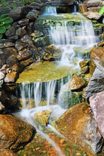 Waterfall Over Colored Rocks