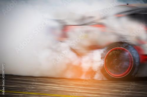 Valokuva  Blurred Race car drifting on speed track on twilight background.