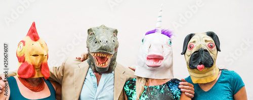 Fotografie, Obraz Happy family wearing different carnival masks - Crazy people having fun wearing