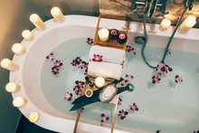 Spa Bath With Flowers, Candles And Tray
