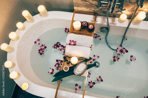 Fotografering Spa bath with flowers, candles and tray