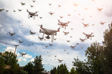 Dozens Of Drones Swarm In The Cloudy Sky