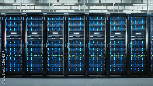 Fotografia Camera Slide-Trough Shot of a Working Data Center With Rows of Rack Servers