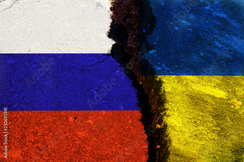 The crack between the flags of Ukraine and Russia Wallpaper Mural