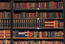 Antique Books On Old Wooden Shelves