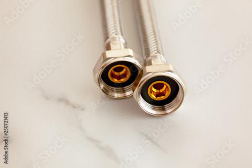 Fotografie, Obraz  Two new flexible metal hoses.