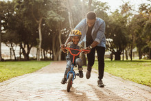 Father Teaching His Son Cyclin...