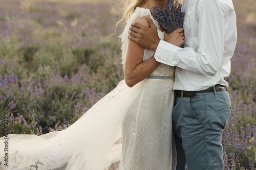 Groom In A White Shirt And Blue Pants And A Bride In A Dress Of
