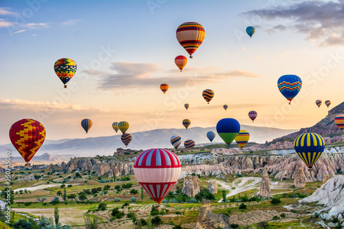 Ingelijste posters Ballon The great tourist attraction of Cappadocia - balloon flight. Cappadocia is known around the world as one of the best places to fly with hot air balloons. Goreme, Cappadocia, Turkey