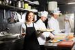 canvas print picture - Waitress in restaurant kitchen