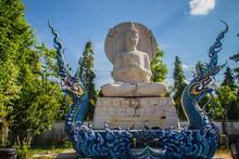 Beautiful White Buddha Sculpture Outside The Church At Wat Rong Sua Ten,ChiangRai,Thailand. Outdoor White Buddha Statue At Wat Rong Sua Ten, Blue Temple, In Chiang Rai, Thailand.