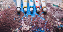 Five White Tubes Of Paint In D...