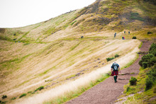 Edinburgh, Scotland - August 12, 2010: Group Of Hikers Hiking Through A Simple Path Near The Capital On A Sunny Saturday.