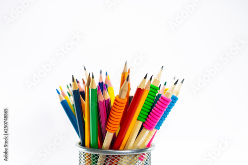 Fotografía Colored pencils in a pencil case on white background