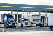 Big Rigs Small Rigs And Middle Rigs Semi Trucks Refuel At The Gas Station