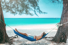 Teenage Boy Chilling In Hammock On The Beach