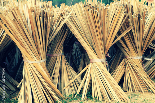 Fotografia Piles of sliced bamboos drying on the floor
