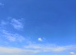 Blue sky with white, soft clouds.The sky is clear.