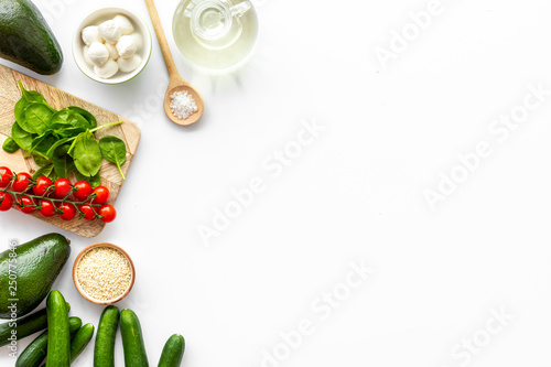 Foto op Plexiglas Kruidenierswinkel Ingredients for fresh vegetable salad on white kitchen desk top view space for text