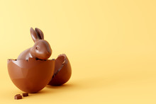 Easter Chocolate Bunny With Egg On Yellow Background. 3d Rendering