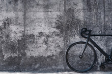 Picture Of A Bicycle In Front Of Big Concrete Wall