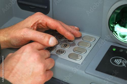 Fotografía  Hands typing pin number hidden