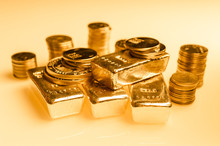 Gold Bars And Stack Of Gold Coins. Background For Finance Banking Concept. Trade In Precious Metals.