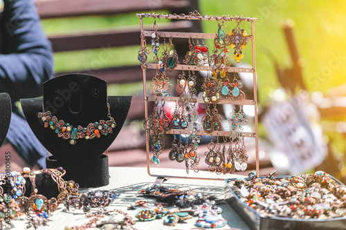 Fotografie, Tablou Oriental handmade earrings for sale at the market fair