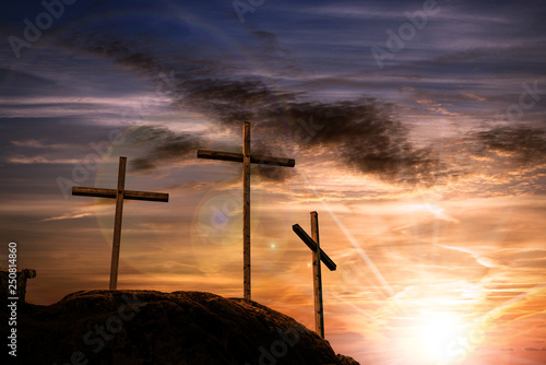Three crosses on a dramatic sky at sunset Wallpaper Mural