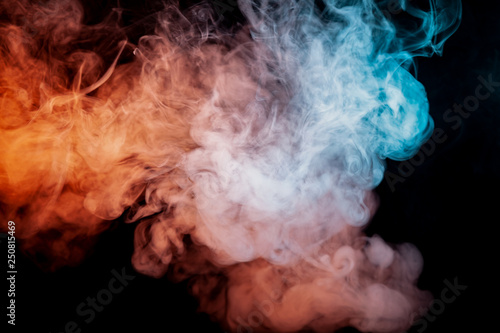 Garden Poster Smoke Background of orange, purple, red and blue wavy smoke on a black isolated ground. Abstract pattern of steam from vape of smoothly rising clubs. Mocap and print for t-shirt.