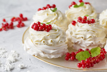 Pavlova Cakes With Cream And Fresh Summer Berries. Close Up Of Pavlova Dessert With Forest Fruit And Mint. Food Photo