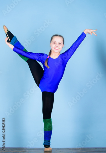 Girl little gymnast sports leotard. Physical education and gymnastics. Future star of rhythmic gymnastics. Rhythmic gymnastics sport combines elements ballet dance. Flexible healthy body. Try hard
