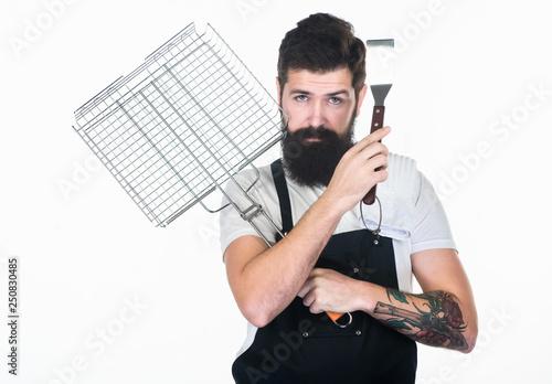 Fényképezés  Bearded hipster wear apron for barbecue