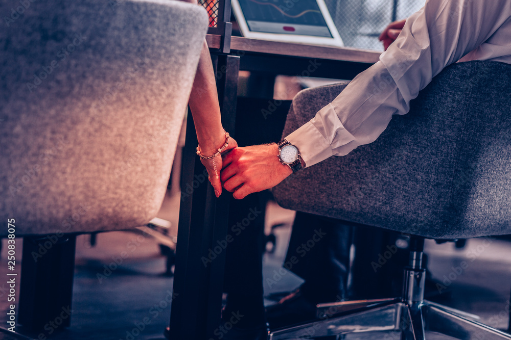 Fototapety, obrazy: Close up of office workers that holding hands