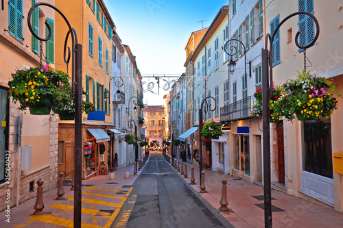 Colorful street in Antibes walkway and shops view Wallpaper Mural