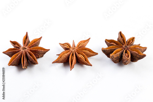 heap of anise stars isolated on white background Canvas Print