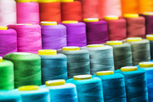 Different Color Spools Of Thread For The Textile Industry. Background