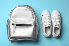 Flat Lay Composition Of Stylish Shoes And Backpack On Color Background