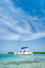 Catamaran Anchored Near De Beach At Los Roques Archipelago  Venezuela On A Sunny Day In A Beautiful Island