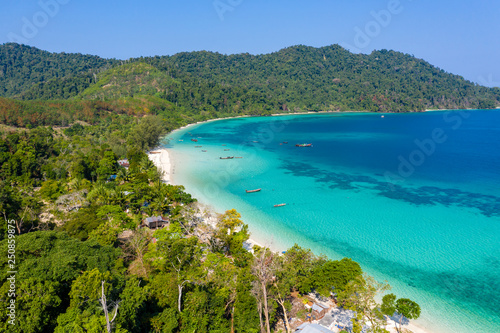 Spoed Foto op Canvas Nieuw Zeeland Aerial drone view of traditional fishing boats moored over a coral reef around a remote, green tropical island in the Mergui Archipelago