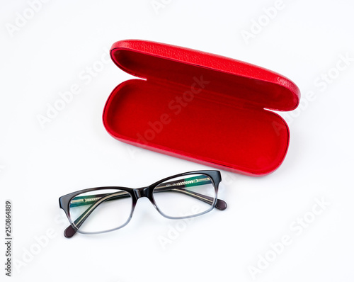 Fotografía Glasses and red case on a white background