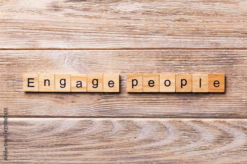 Fotografie, Obraz  ENGAGE PEOPLE word written on wood block