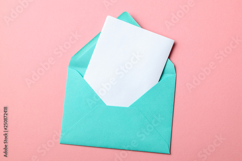 Fototapeta Green envelope and blank letter on pink background obraz
