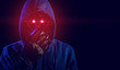 red eye hacker with blue hood outfit and mask with glove on dark background in security virus network and ai hologram robotic concept