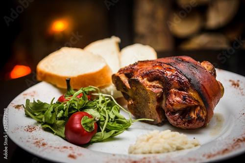 Fototapeta roasted pork knuckle with bread and horseradish obraz
