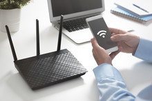 Wireless Router Concept. Man Using Smartphone