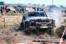 Ukrainian Offroad Competition In The City Of Kamyanets Podilsky. Swamp And Mud On Cars. Produce Large Puddles