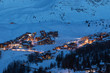 View of high altitude ski resorts in French Savoy Alps in twilight: Plagne Centre, Plagne Soleil and Plagne Village